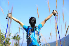 Thankful woman climber. Thankful hiking woman climber open arms mountain peak Royalty Free Stock Photo