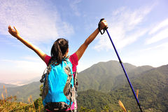 Thankful woman climber. Thankful hiking woman climber open arms mountain peak Royalty Free Stock Photography