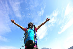 Thankful woman climber. Thankful hiking woman climber open arms mountain peak Royalty Free Stock Image