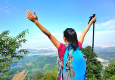 Thankful woman climber. Thankful hiking woman climber open arms mountain peak Royalty Free Stock Images