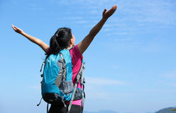 Thankful woman climber mountain peak Stock Photography