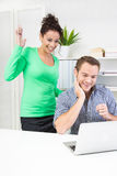 Thankful woman standing behind her colleague in office chatting Stock Image