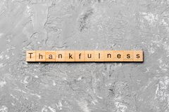 Thankfulness word written on wood block. Thankfulness text on cement table for your desing, concept