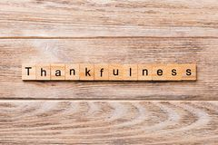 Thankfulness word written on wood block. Thankfulness text on wooden table for your desing, concept