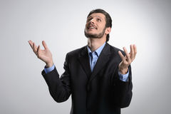Thanking God. Cheerful bearded man in formalwear standing with h Royalty Free Stock Image