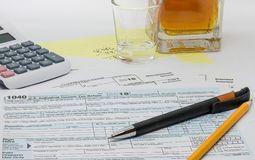 The thankless, frustrating and depressing task of preparing the annual tax return stock images