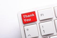 Thanks. Or thank you concept with word on conputer key or button Stock Photography