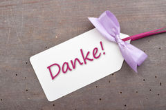 Thanks. Label with lettering thanks and violet loop Stock Image