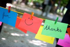 Thanks. Colorful paper sheets with words Fun, Thanks and smile Royalty Free Stock Photography