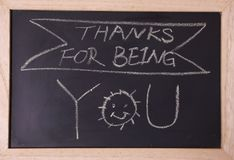Thanks for being you blackboard. Sign. Thank you written with chalk on black chalkboard with frame Stock Image