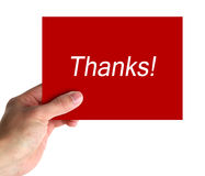 Thanks Card. Card in hand with lettering thanks on white background royalty free stock images