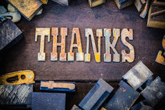 Thanks Concept Rusty Type. The word THANKS written in rusted metal letters surrounded by vintage wooden and metal letterpress type Stock Photos