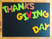 Thanks giving day wooden word on black board Stock Photography