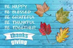 Thanks giving greeting poster card with four leaf on blue wood. En table stock photos