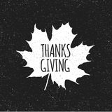 Thanks giving. Vector. White maple leaf with Thanksgiving text on black background. Logo, web concept. Thanks giving. Vector. White maple leaf with Thanksgiving Royalty Free Stock Image