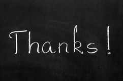 Thanks. Lettering written with chalk on blackboard Royalty Free Stock Image