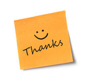 Thanks message on adhesive note. Adhesive note on white background Royalty Free Stock Images