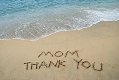 Thanks Mom. Thanks Message left in the sandy beach Stock Photos