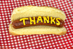 Thanks in mustard on hot dog Stock Photos