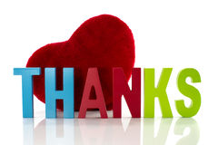 Thanks with red heart. Thanks letters with red heart from fabric Royalty Free Stock Image