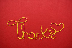 Thanks ribbon greeting and hearts on red background Royalty Free Stock Images