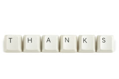 Thanks from scattered keyboard keys on white. Thanks text from scattered keyboard keys isolated on white background royalty free stock image