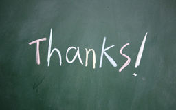 Thanks symbol. Write with chalk on blackboard Stock Images