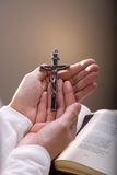 Thanks to God. Christian believer holding old cross in hand Stock Photography