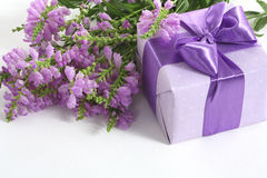 Thanks to you!. Beautiful violet present and gift box liyng on the white background Stock Photos