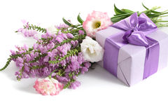 Thanks to you!. Beautiful violet present and gift box liyng on the white background Stock Image
