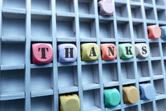 Thanks word made with building wooden blocks stock images