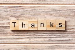 Thanks word written on wood block. thanks text on table, concept.  Royalty Free Stock Photo