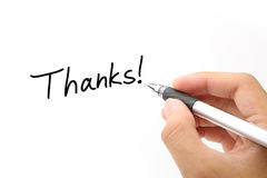 Thanks!. Thanks writing and ball-point pen in hand on white paper Royalty Free Stock Images