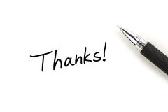 Thanks!. Thanks writing and ball-point pen on white paper royalty free stock photo