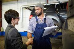 Thanks for your visit. Master of garage and his client handshaking after car diagnostics stock photos