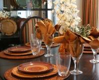 Thanksgiving. Dining room table elegantly set for Thanksgiving