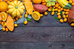 Thanksgiving Autumn Background, Variety of Orange Fruits and Vegetables on Dark Wooden Background with Free Space for Text. Horizontal View Royalty Free Stock Photo