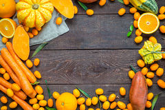 Thanksgiving Autumn Background, Variety of Orange Fruits and Vegetables on Dark Wooden Background with Free Space for Text. Top View Stock Image