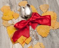 Thanksgiving in the autumn, consisting of cutlery and the location of falling leaves and ropes on a wooden background with a place royalty free stock photography