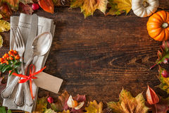 Thanksgiving autumn place setting. With cutlery and arrangement of colorful fall leaves stock images