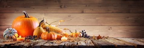 Thanksgiving Background - Pumpkins With Corncob And Candles. On Rustic Wooden Table royalty free stock images