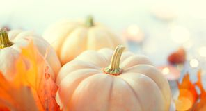 Thanksgiving background. Wooden table, decorated with pumpkins, autumn leaves and candles stock photo