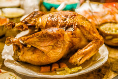 Thanksgiving baked turkey bird on the dinner table ready to eat Royalty Free Stock Photo