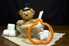 Thanksgiving Bear Making Pumpkin Shaped Cookies Stock Photography