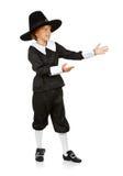 Thanksgiving: Boy Pilgrim Gestures to Side Royalty Free Stock Image