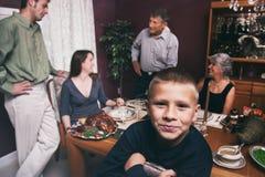 Thanksgiving: Boy Smiles To Camera During Thanksgiving Dinner stock image