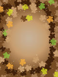 Thanksgiving brown background frame leafs. Thanksgiving brown background frame with fall leafs and shiny little stars Stock Photo