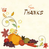 Thanksgiving celebration card with veg and fruits. Thanksgiving card with veg and fruits decoration and stylish text of Give Thanks on beige background Royalty Free Stock Photos