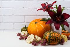 Thanksgiving centerpiece with burgundy red lily stock photo