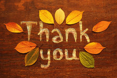 Thanksgiving. Chalk  inscription thank you and autumn leaves Stock Photo